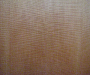 Highly-figured-bookmatched-anigre-veneer-in-custom-cabinetry-m
