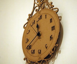 Laser-cut-corrugated-card-clocks-by-the-rise-set-m