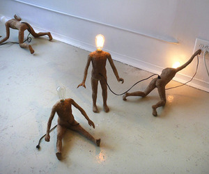 Miniature Human Sculptures Struggle For Power