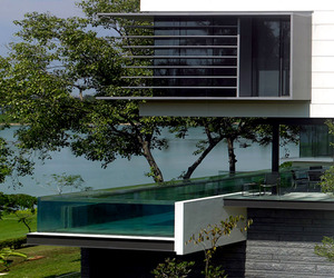 Modernist-home-with-suspended-pool-by-scda-m