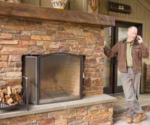 Outdoor-brick-fireplace-with-wood-mantel-by-bill-fry-m