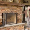 Outdoor-brick-fireplace-with-wood-mantel-by-bill-fry-s