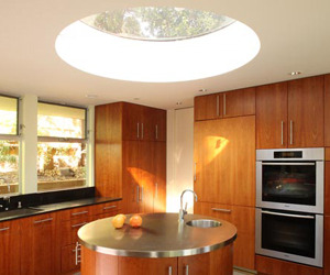 Round-stainless-steel-topped-kitchen-island-round-skylight-m