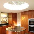 Round-stainless-steel-topped-kitchen-island-round-skylight-s