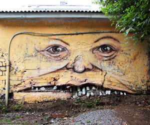 Street Artist Creates Faces on Buildings | Nikita Nomerz 