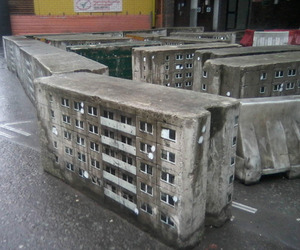 Street-artist-paints-miniature-buildings-around-the-city-m