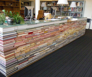 Table-made-of-books-in-library-m