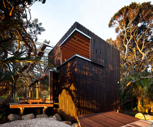 Under-pohutukawa-beach-house-by-herbst-architects-m
