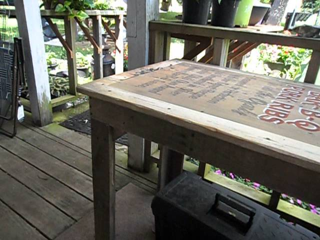old sign and oak pallet table