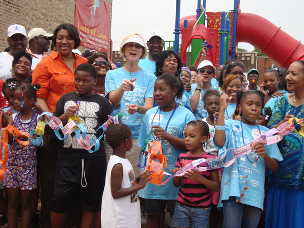 PCBS President Karen Atwood and Blue Corps volunteers at the 100th Chicago KaBOOM! playground build