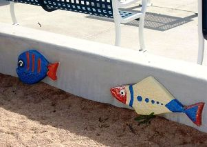 Colorful fish along the sitting wall