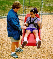 Swings with extra support are helpful for many children