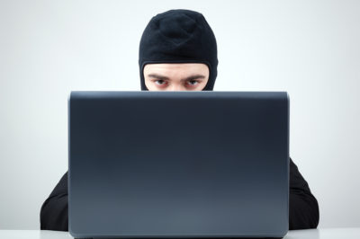 bigstock-Portrait-of-a-hacker-with-bala-44699971