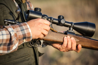 bigstock-full-hunter-hunting-rifle-52318252