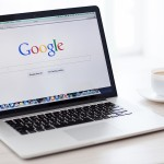 Macbook Pro Retina With Google Home Page On The Screen Stands On