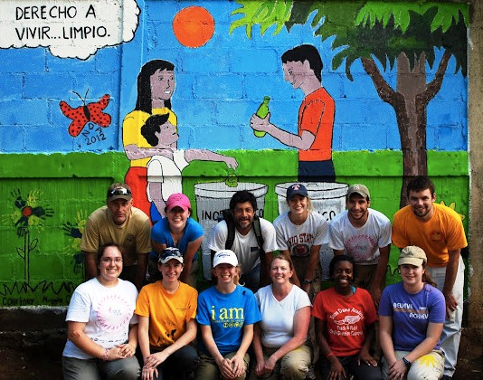 "The NDA Nicaragua Crew posing in front of our finished mural. ""Derecho a vivir...limpio"" which means ""The right to live...clean."""