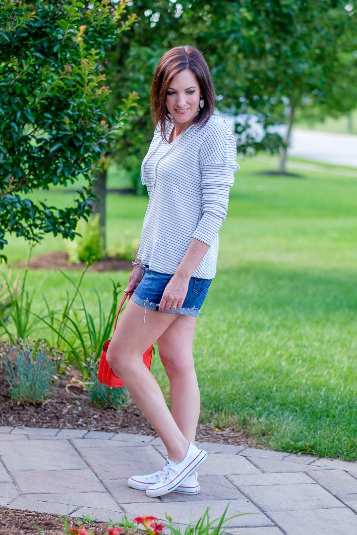 I've always liked the juxtaposition of long sleeves with shorts in the summertime, and this blue and white stripe pullover is the perfect thing to throw on with your favorite denim shorts and sneakers.