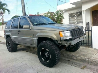 Jepp Grand cherokee limited 1996 Oro