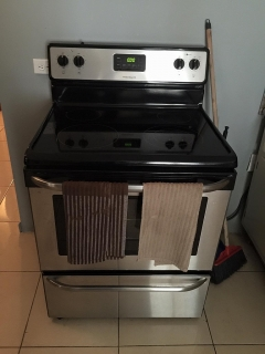 Kenmore Glass top electric stove with stainless steel finish.