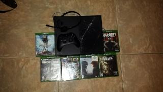 xbox one, con varios juegos