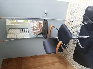 Estación, silla y alfombra de estilismo