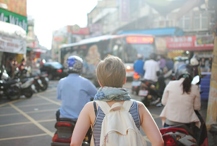 Skillcrush_Geolocation apps_Backpacker in busy city