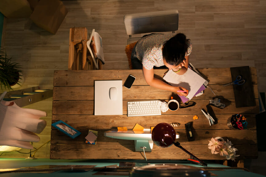Woman working at home at night