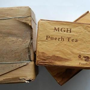 2011 MGH 1109 Mangfei Green Pu-erh Tea Brick from PuerhShop.com