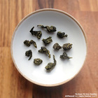 Tie Guan Yin (Iron Buddha) from driftwood tea