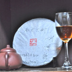 2012 Yi Wu Shan Da Ye Sheng Bing Stone-Pressed (Yi Wu Mountain Green Puer Cake) 357g 1 pc from Misty Peak Teas