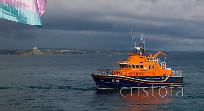 RLNI lifeboat off Penzance waterfront with St Michael's Mount in the background