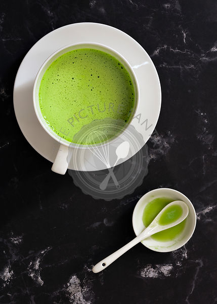 Matcha green tea in a cup.