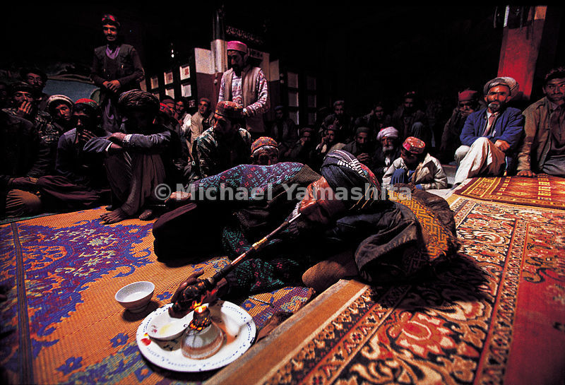 Opium smokers in Qualeh Panjah, Afghanistan.
