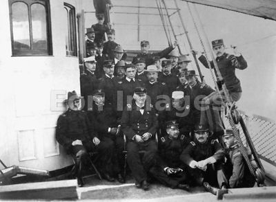 Wesley Merritt with officers on board the USS Newport