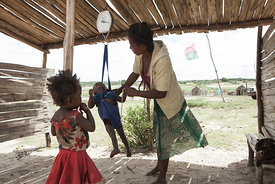 This picture taken on March 4, 2015 shows a woman checking the weight of her baby at the health center of the village of Imongy, in the Tsihombe district of southern Madagascar. The World Food Program, whose food distribution currently allows 120,000 people to survive, is asking for international aid as an exceptional drought from October 2014 through February 2015 destroyed crops in the region.