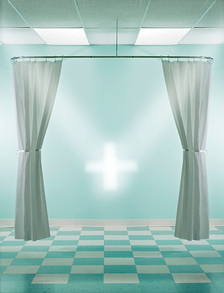 hospital room with cross of light and curtains