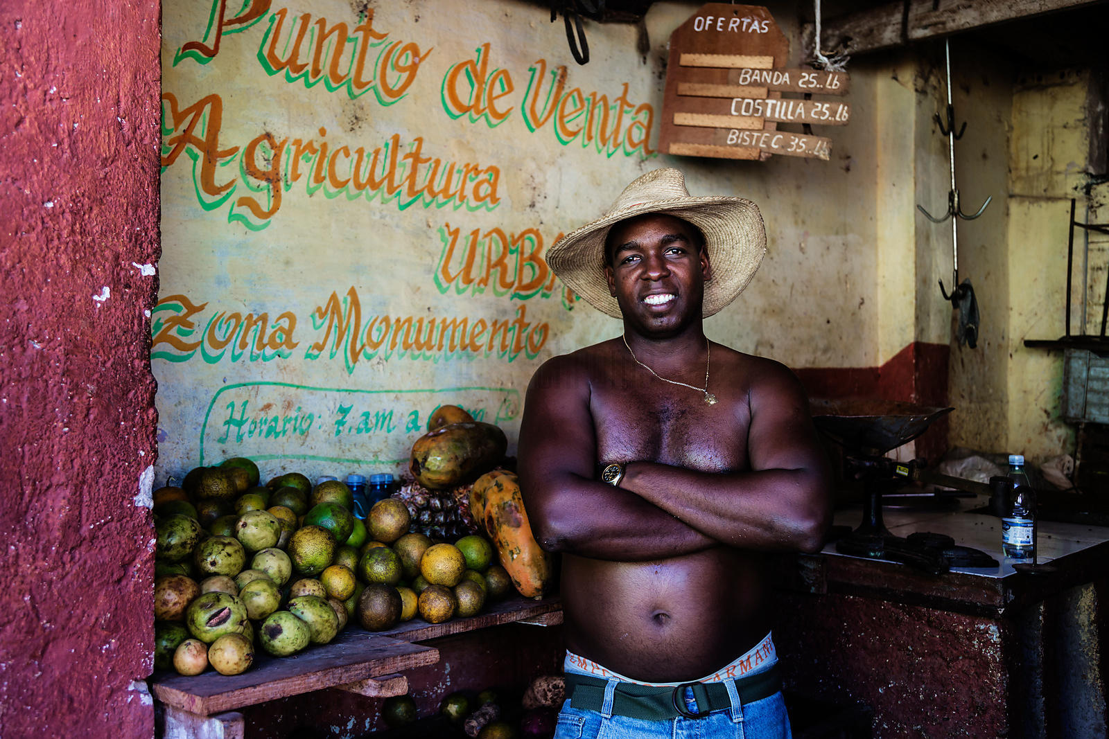 Portrait of a Fruit Seller in his Store