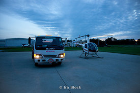 A Robinson R22 helicopter next to a fuel truck at Fostaire Helicopters base in East St. Louis, Illinois.