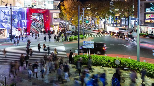 Medium Shot: 75 Degree Pan Of A Busy Shibuya Intersection