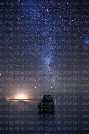 Toyota Land Cruiser and Milky Way in rainy season, Salar de Uyuni, Bolivia