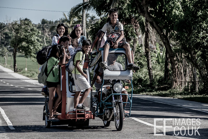 The School Run II - Kids Coming Home From School By Tricycle In The Philippines