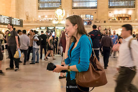 A woman on the phone at the Grand Central Terminal in NY.