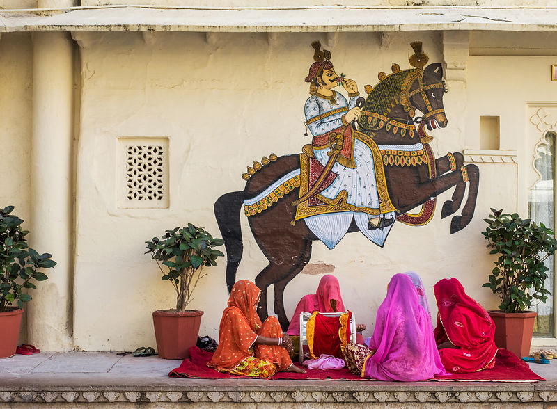 A group of folk artists perform at the city palace, Udaipur