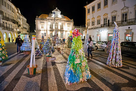 Little Christmas trees made of recycled materials in Giraldo square near the cathedral, at dusk. Évora, a UNESCO World Heritage Site. Portugal