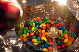 M&M chocolate candies on a table at a party.