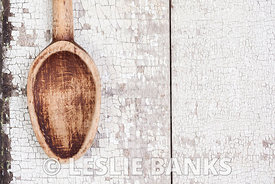 Vintage wooden spoon on rustic table