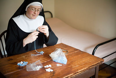 Sister Ruth making rosary beads