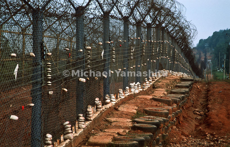 The heavily fortfied fence along the Demilitarized Zone (DMZ) divides the two Koreas.