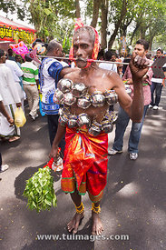 Thaipusam festival, body piercing is conducted by devotees, Penang, Malaysia 2011.