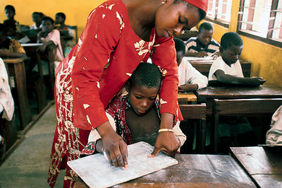 Ghana - Tamale - A street child is helped to read